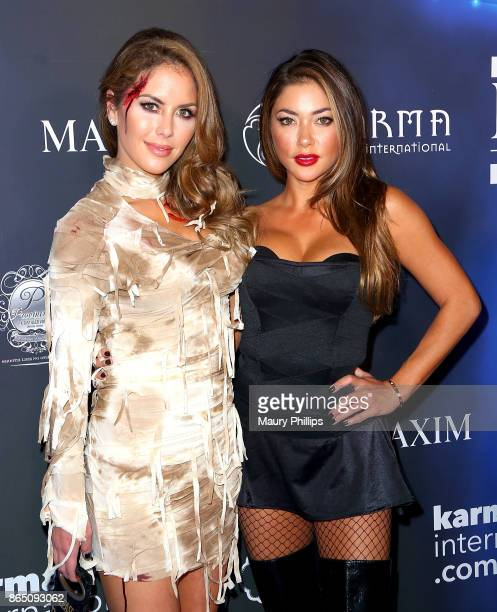 Brittney Palmer and Arianny Celeste arrive at the 2017 Maxim Halloween Party at Los Angeles Center Studios on October 21 2017 in Los Angeles...