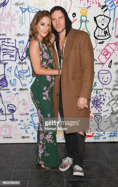Brittney Palmer and Gregory Siff at Gregory Siff Studios and 4AM Gallery Opening at Dream Hollywood on October 10 2017 in Los Angeles California
