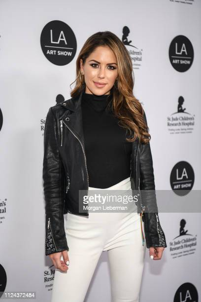 Brittney Palmer arrives at the LA Art Show 2019 Opening Night Gala at the Los Angeles Convention Center on January 23 2019 in Los Angeles California