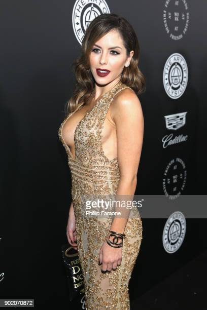 Brittney Palmer attends The Art Of Elysium's 11th Annual Celebration with John Legend at Barker Hangar on January 6 2018 in Santa Monica California