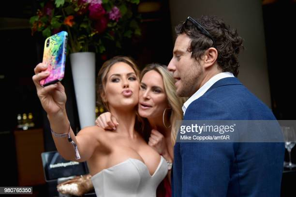 Brittney Palmer Danielle Epsteinnd Gregory Siff pose for a selfie during the amfAR GenCure Solstice 2018 on June 21 2018 in New York City