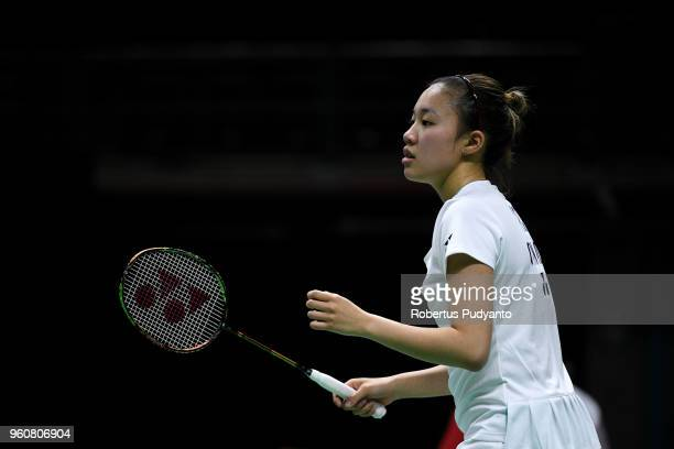 Brittney Tam of Canada competes against Sayaka Sato of Japan during Preliminary Round on day two of the BWF Thomas Uber Cup at Impact Arena on May 21...