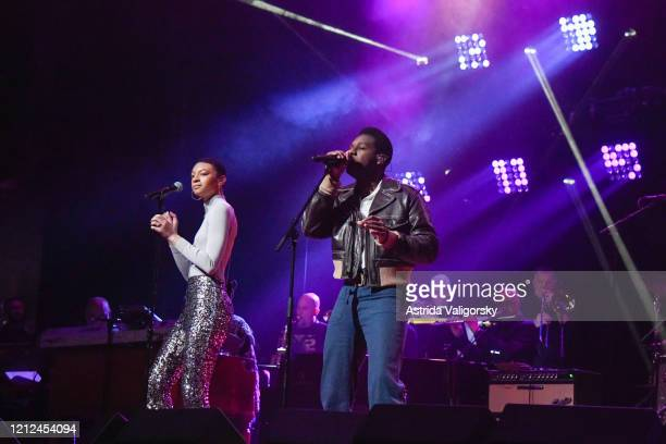 Brittni Jessie and Leon Bridges perform on stage during the Fourth Annual LOVE ROCKS NYC benefit concert for God's Love We Deliver at Beacon Theatre...