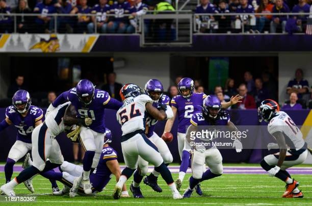 Britton Colquitt of the Minnesota Vikings punts the ball in the second quarter of the game against the Denver Broncos at US Bank Stadium on November...