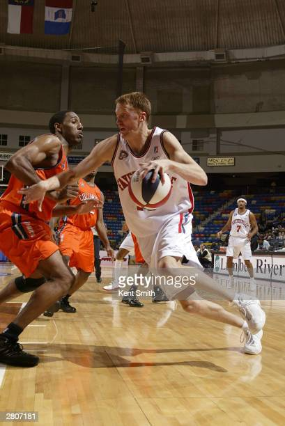 Britton Johnsen of the Fayetteville Patriots drives to the basket the against the Columbus Riverdragons December 12, 2003 at the Crown Coliseum in...