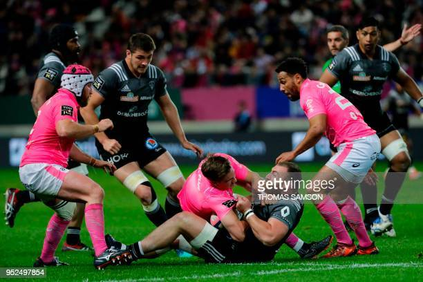 Brive's Georgian prop Soso Bekoshvili vies with Stade Francais' French scrum-half Clement Daguin during the French Top 14 rugby union match between...