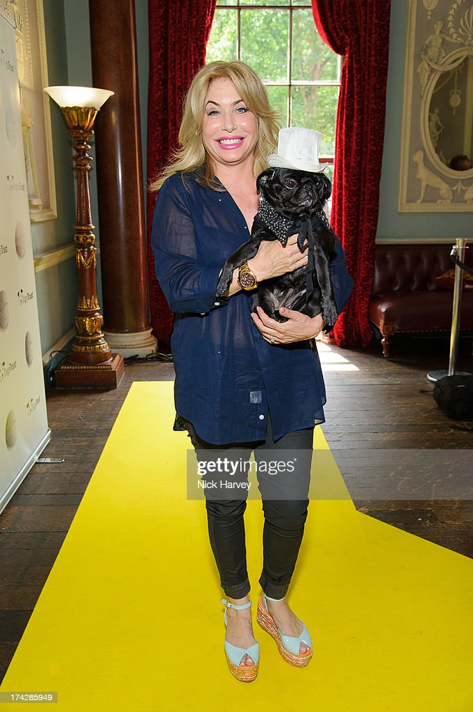 Brix Smith-Start and Gladys attend the Dogs Trust Honours 2013 at Home House on July 23, 2013 in London, England.