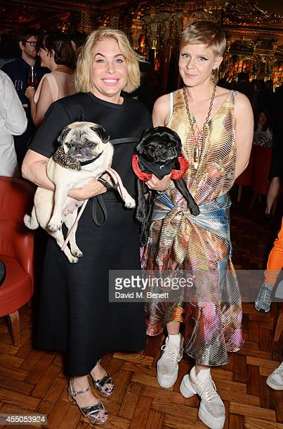 Brix SmithStart and Robyn pose with dogs Pixie and Gladys at 'The Gentlewoman' issue launch party at the Oscar Wilde Bar at The Club at Cafe Royal on...