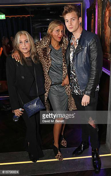 Brix SmithStart Azzi Glasser and guest attend the launch of MNKY HSE latenight restaurant Mayfair on October 19 2016 in London England