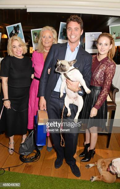 Brix SmithStart CEO of Dogs Company Clarissa Baldwin Harry Langton with dog Iggy and Rosie Fortescue attend Dogs Trust at George on September 9 2014...
