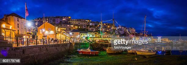 Brixham harbour picturesque fishing village illuminated dusk panorama Devon UK