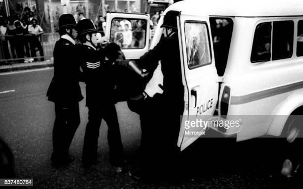 Brixton Riots July 1981 Police officers struggle to arrest man and put him back of police van.