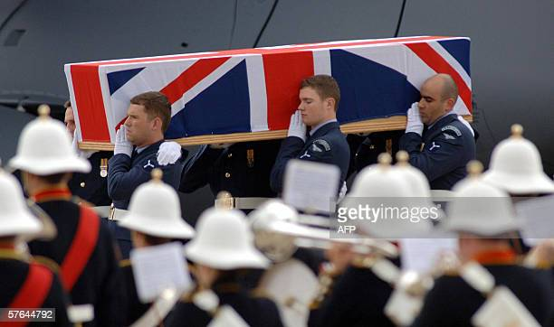 The coffin of Flight Lieutenant SarahJayne Mulvihill the first British service woman to die in Iraq arrives at RAF Brize Norton in Oxfordshire 18 May...