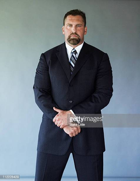 Broad man wearing business suit