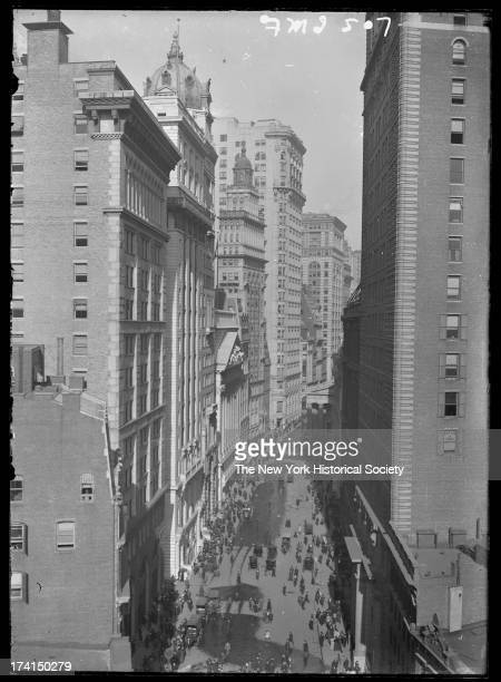 Broad Street looking north showing the Dow Building and the New York Stock Exchange New York New York mid to late 1900s