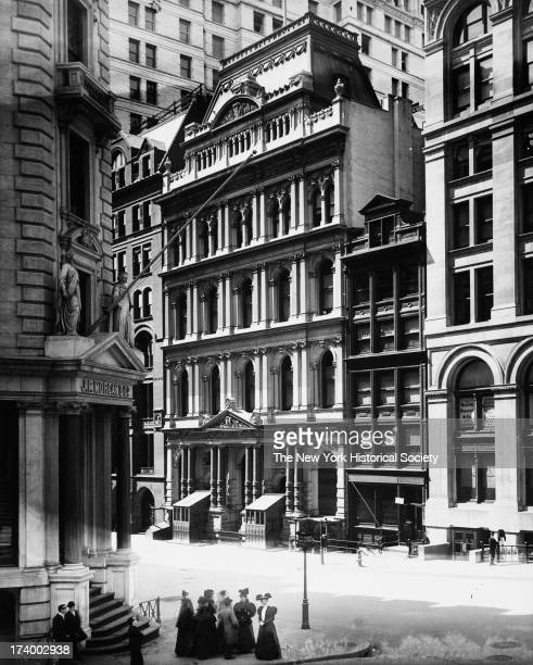 Broad Street south of Wall Street west side showing New York Stock Exchange with temporary wooden entrance vestibules JP Morgan Co Building New York...