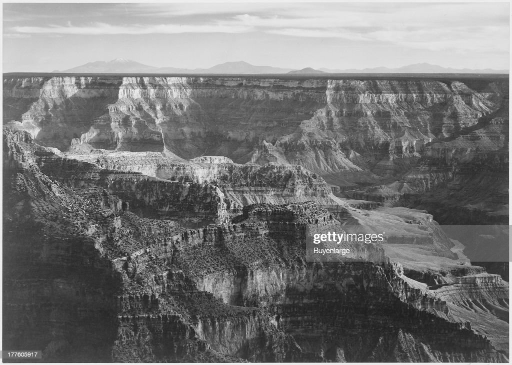 Broad view with detail of canyon horizon and mountains above Grand Canyon National Park, Arizona, 1942.