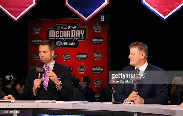 TSN broadcast analyst Aaron Ward speaks as fellow analyst Marc Crawford looks on during an NHL Network broadcast at the 2012 NHL AllStar Game Player...