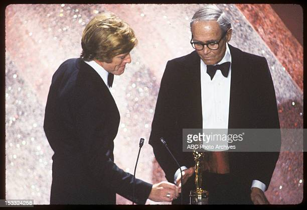Broadcast Coverage - Airdate: March 31, 1981. HONORARY OSCAR PRESENTER ROBERT REDFORD WITH RECIPIENT HENRY FONDA