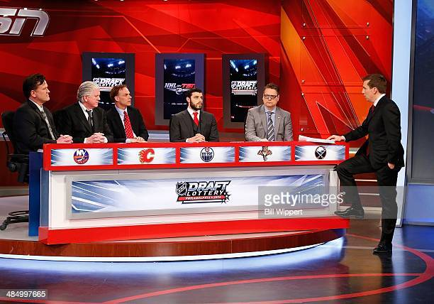 Broadcast host James Duthie stands with team representatives attending the 2014 NHL Draft Lottery on April 15 2014 at the TSN Studios in Toronto...