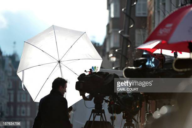 A broadcast journalist and cameras are pictured outside the central London hospital on December 5 where Britain's Catherine Duchess of Cambridge is...