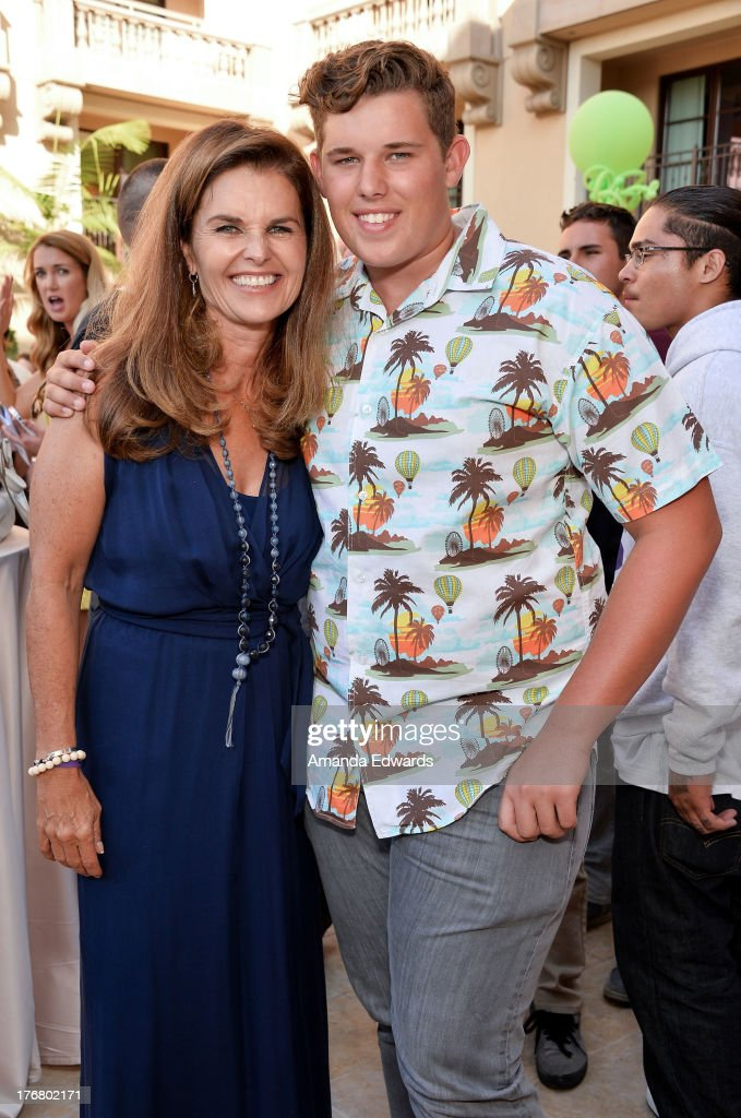 Broadcast journalist Maria Shriver (L) and her son Christopher Schwarzenegger attend the Team Maria benefit for Best Buddies at Montage Beverly Hills on August 18, 2013 in Beverly Hills, California.