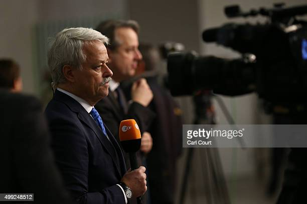 A broadcast journalist talks to camera as he works at the United Nations Climate Summit on November 30 2015 in Paris France Political leaders from...