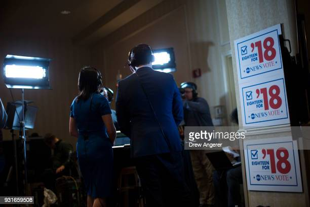Broadcast journalists report at an election night event for Conor Lamb Democratic congressional candidate for Pennsylvania's 18th district March 13...