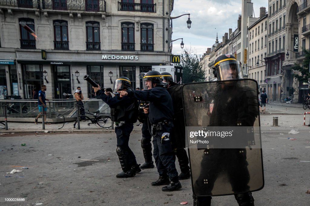 Police And Football Fans Clash In Lyon After France's World Cup Victory
