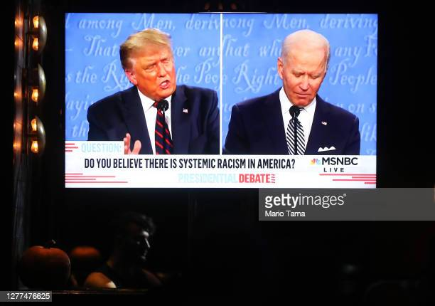 A broadcast of the first debate between President Donald Trump and Democratic presidential nominee Joe Biden is played on a TV at The Abbey which...