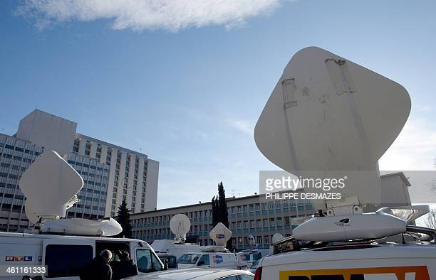 Broadcast vans of the international medias are parked on January 7 2014 in front of the Grenoble University Hospital Centre in the French Alps where...