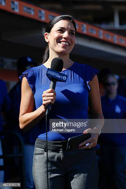 Broadcaster Alanna Rizzo of the Los Angeles Dodgers reports for the dugout during the game against theSan Francisco Giants at ATT Park on October 1...