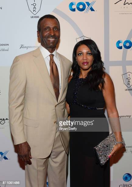 Broadcaster and former professional basketball player Eddie Johnson and Joy Johnson arrive at the Coach Woodson Las Vegas Invitational red carpet and...