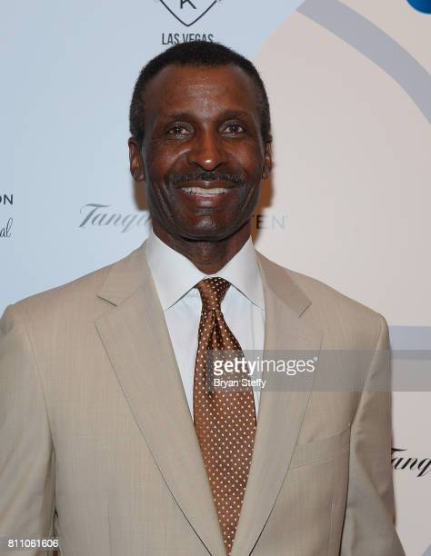 Broadcaster and former professional basketball player Eddie Johnson arrives at the Coach Woodson Las Vegas Invitational red carpet and pairings gala...