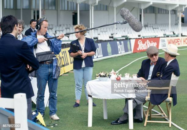 Broadcaster and journalist Henry Blofeld in conversation with former Yorkshire and England cricketer Geoffrey Boycott whilst being filmed taking...