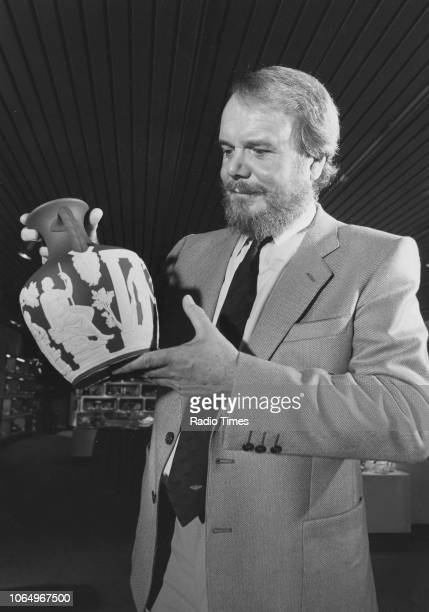 Broadcaster Brian Redhead inspecting a Jasperware vase during a visit to the Wedgwood Factory in Stoke-on-Trent, photographed for Radio Times in...