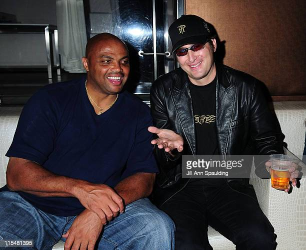 Broadcaster Charles Barkley of TNT and Poker Pro Phil Hellmuth arrives at AUFA Celebrity Poker Tournament After Party at Pure Nightclub on July 2...