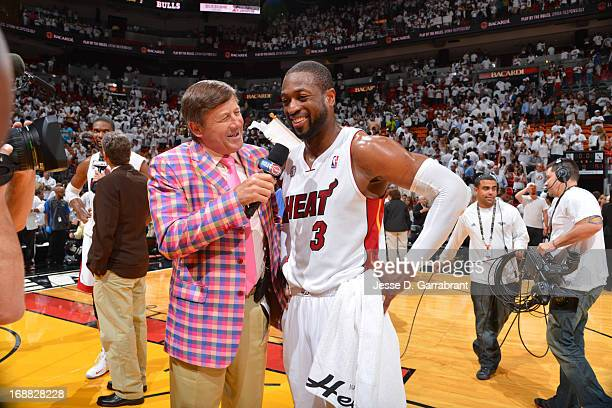 TNT broadcaster Craig Sager speaks with Dwyane Wade of the Miami Heat after their win against the Chicago Bulls in Game Five of the Eastern...