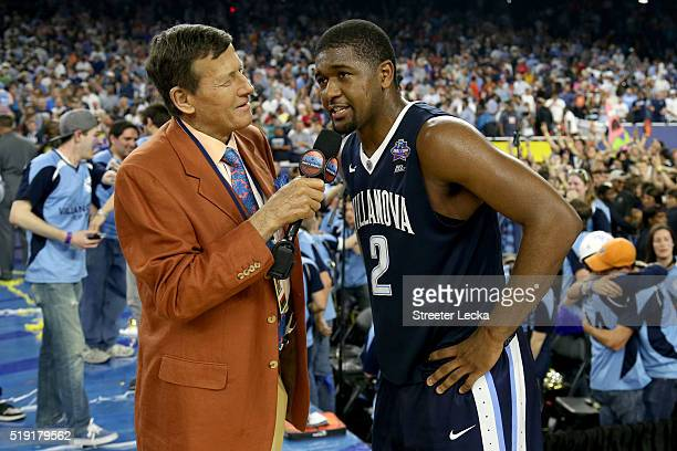 Broadcaster Craig Sager talks with Kris Jenkins of the Villanova Wildcats after making the gamewinning three pointer to defeat the North Carolina Tar...