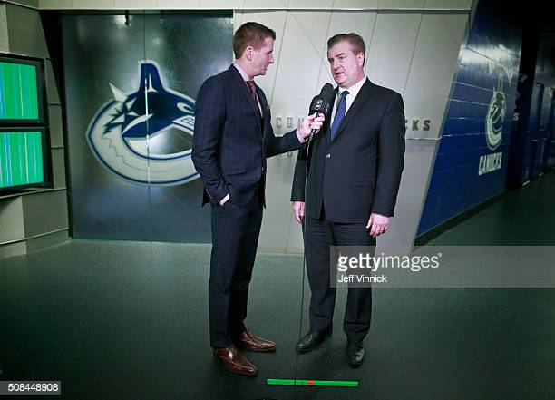 Broadcaster Dan Murphy of Sportsnet interviews general manager Jim Benning of the Vancouver Canucks before their NHL game against the Columbus Blue...