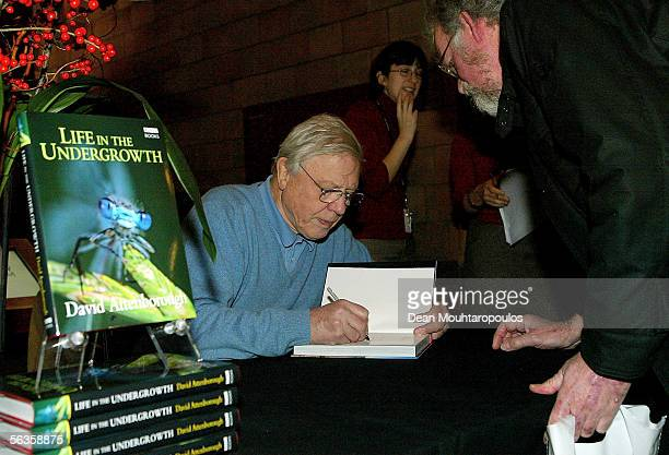 Broadcaster David Attenborough signs copies of his latest publication Life In The Undergrowth published in relation to the BBC One series at the...