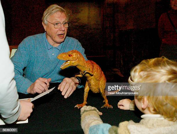 Broadcaster David Attenborough speaks to a young fan as he signs copies of his latest publication Life In The Undergrowth published in relation to...