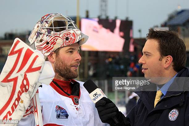 CBC broadcaster Elliotte Friedman interviews winning goaltender Ty Conklin of the Detroit Red Wings after the NHL game against the Chicago Blackhawks...