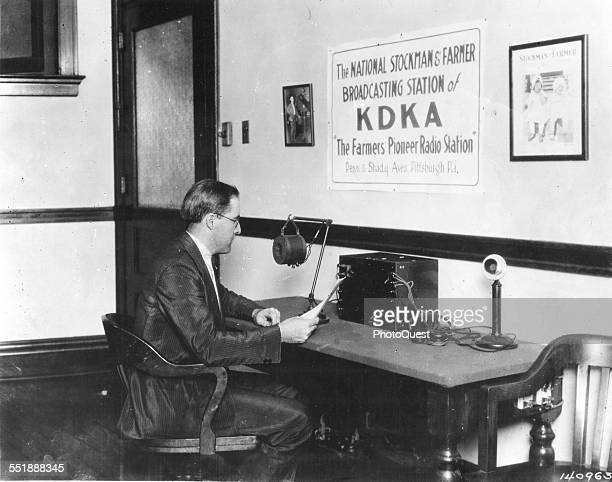 Broadcaster Frank Mullen reads copy into the microphone at KDKA one of American first commercial radio stations Pittsburgh Pennsylvania 1922