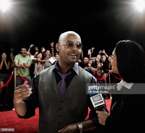 broadcaster interviewing celebrity - celebrities photos stock pictures, royalty-free photos & images