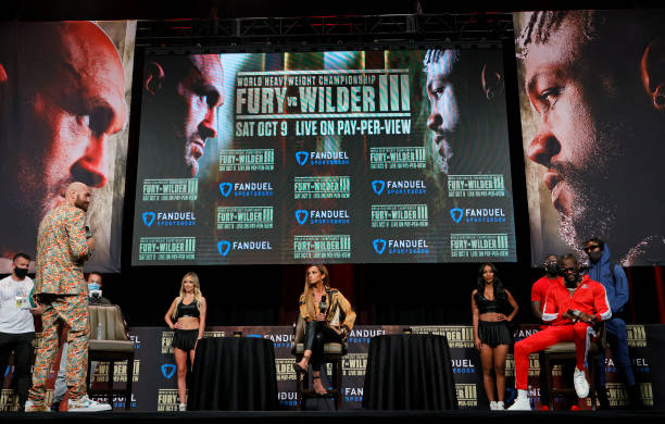 Broadcaster Kate Abdo moderates a news conference for WBC heavyweight champion Tyson Fury and Deontay Wilder at MGM Grand Garden Arena on October 6,...