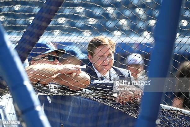 TORONTO ON JULY 26 Broadcaster Matt Devlin talks with Toronto Blue Jays manager John Gibbons scrum as the Toronto Blue Jays play the San Diego Padres...