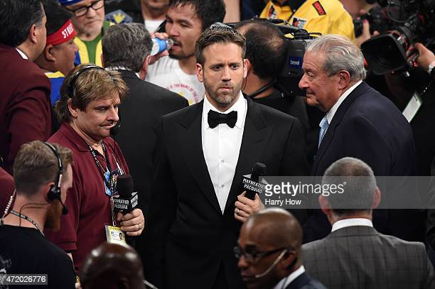 Broadcaster Max Kellerman stands in the ring after Floyd Mayweather Jr defeats Manny Pacquiao by unanimous decision in their welterweight unification...
