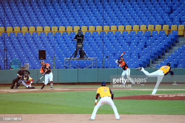 A broadcaster operates a camera during the opening match between Uni President Lions against Chinatrust Brothers during the Chinese Professional...