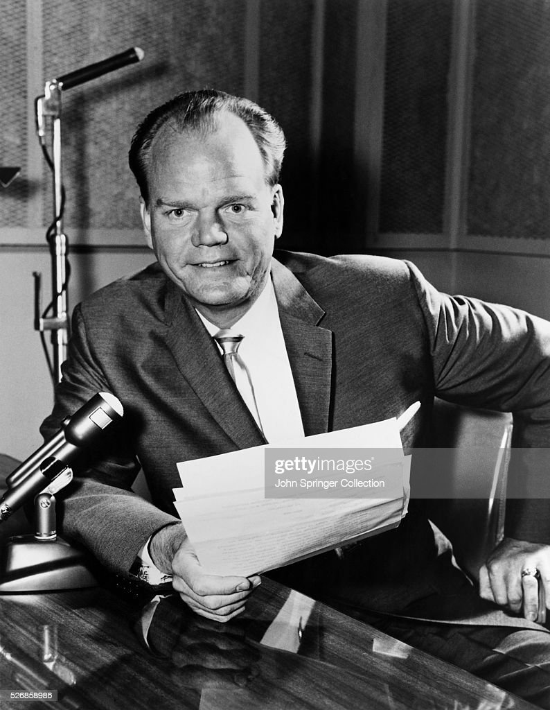 Broadcaster Paul Harvey Sitting with Microphone : News Photo